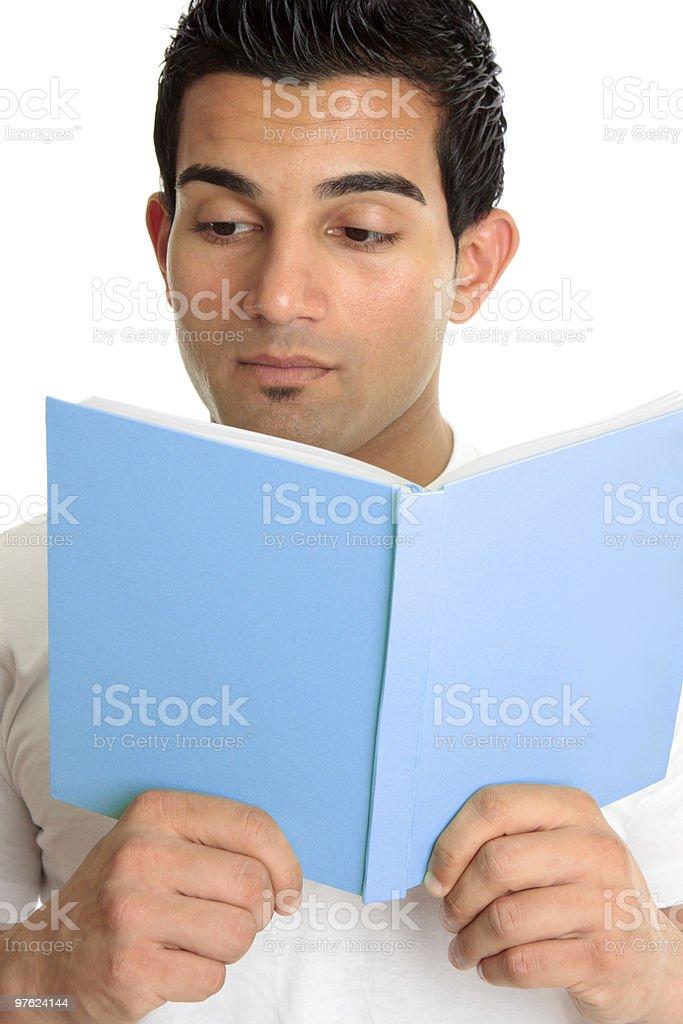 Closeup of a man readinsg book royaltyfri bildbanksbilder
