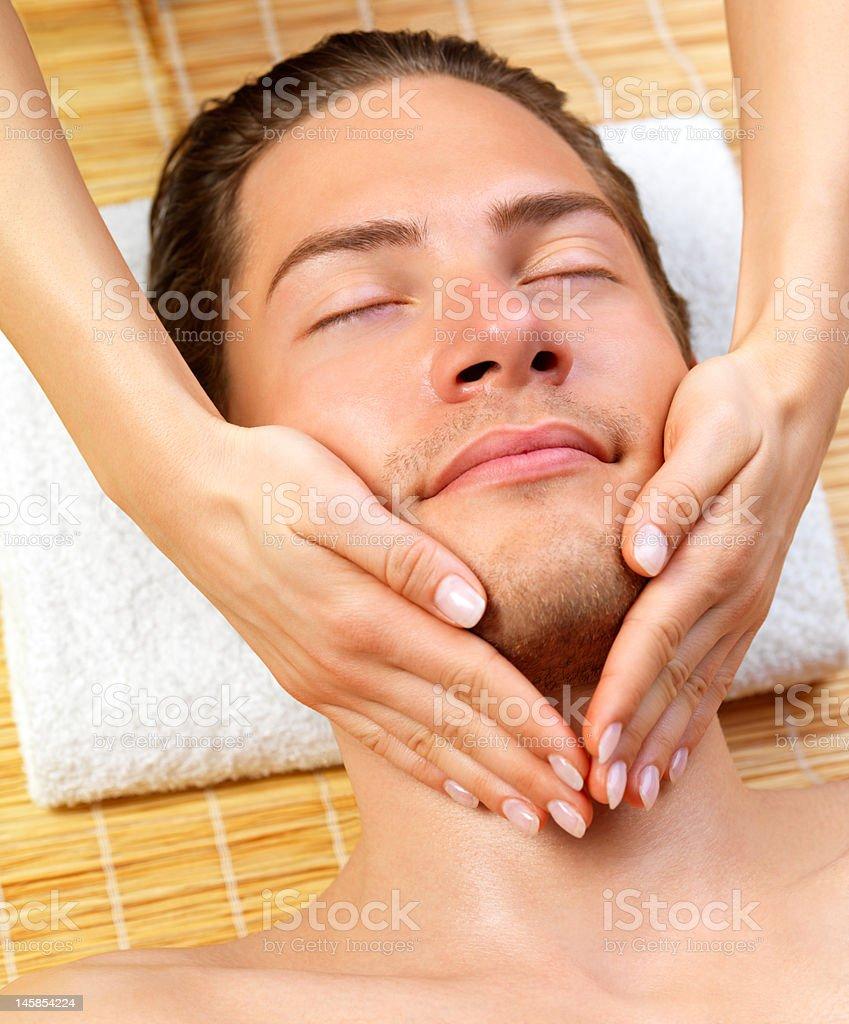 Close-up of a man receiving facial massage royalty-free stock photo