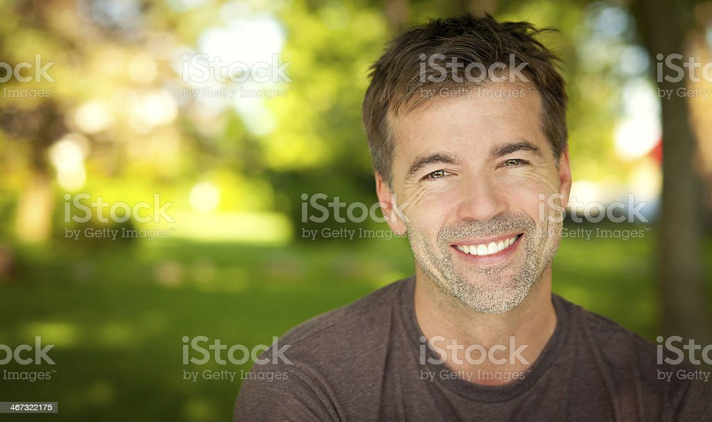 Close-up of a man smiling outside stock photo