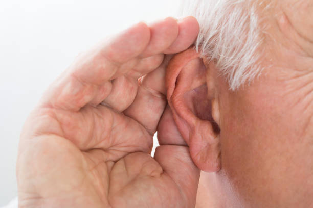 close-up of a man trying to hear - ear stock photos and pictures