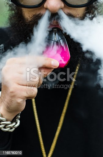 istock Close-up of a man vaping an electronic cigarette 1165780010