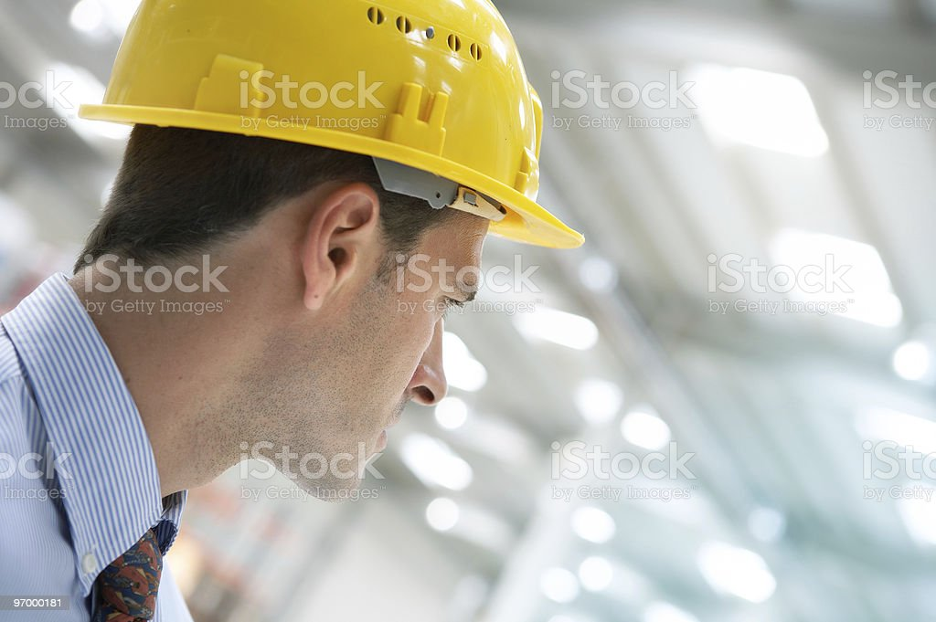 Close-up of a man wearing impact resistant yellow hat royalty-free stock photo