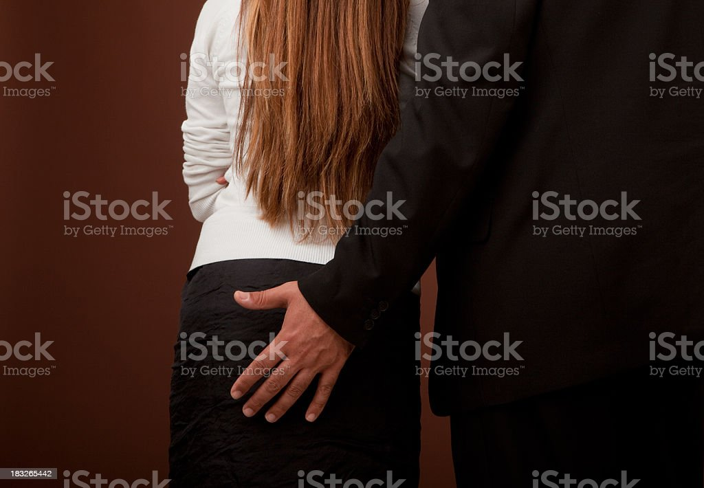 Close-up of a man with his hand on a woman's bottom stock photo