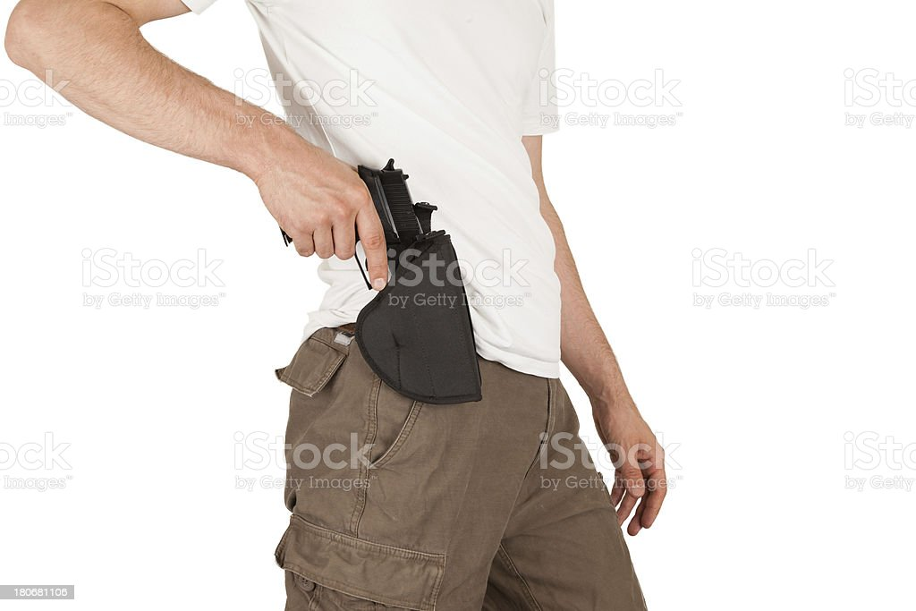 Close-up of a man with holster and gun royalty-free stock photo