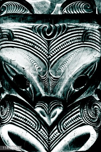 A close-up image of a Maori Carving on a building.