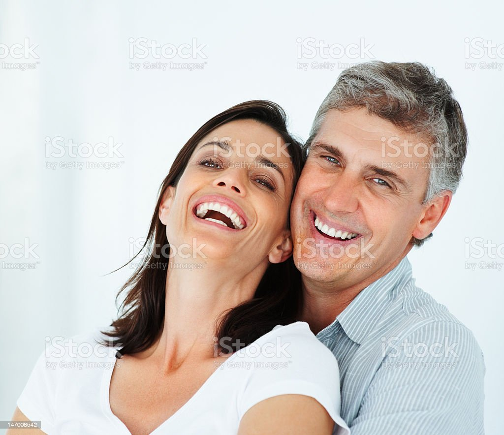 Close-up of a mature couple laughing stock photo