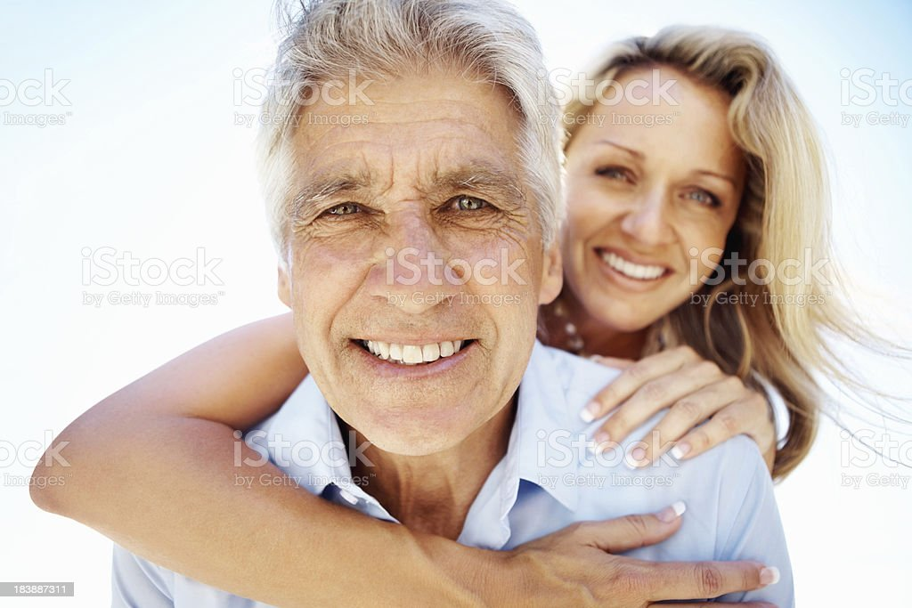 Closeup of a mature man embraced by woman royalty-free stock photo