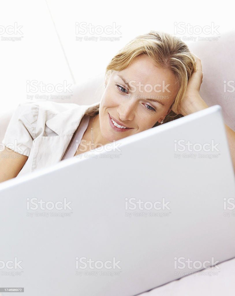 Close-up of a mature woman using laptop on sofa royalty-free stock photo