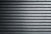 Closeup of a metal gate typically found on buildings