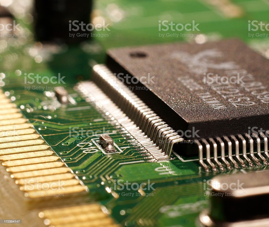 A close-up of a microchip circuit board royalty-free stock photo