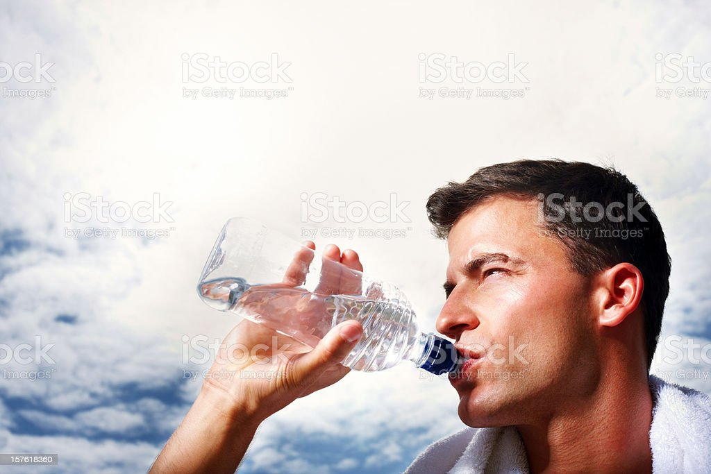 Close-up of a middle aged man drinking water after workout royalty-free stock photo