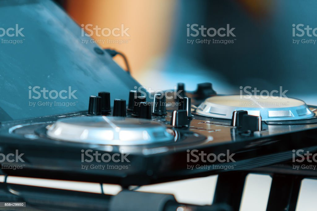 Close-up of a mixing dj machine with knobs stock photo