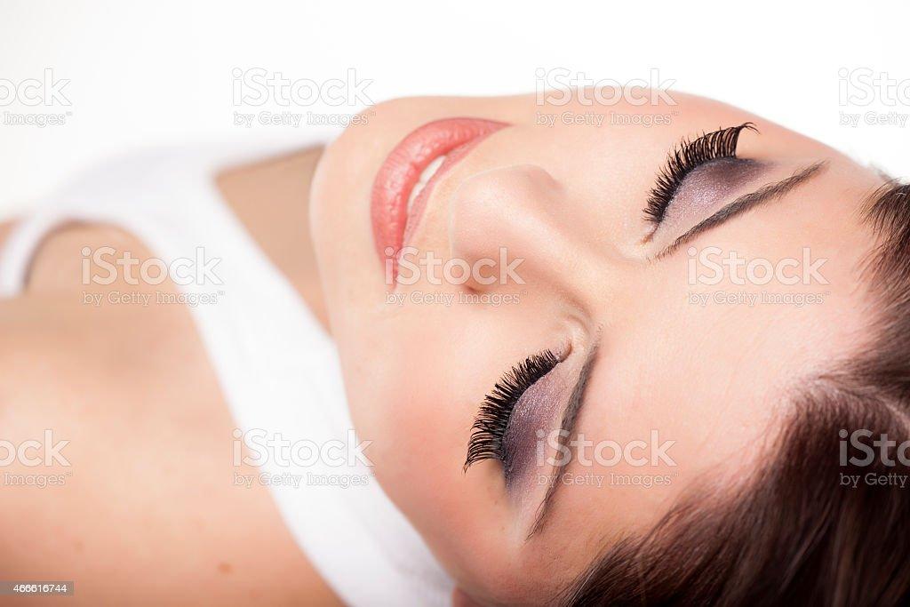 Closeup Of A Model Laying Down Wearing False Eyelashes Stock Photo