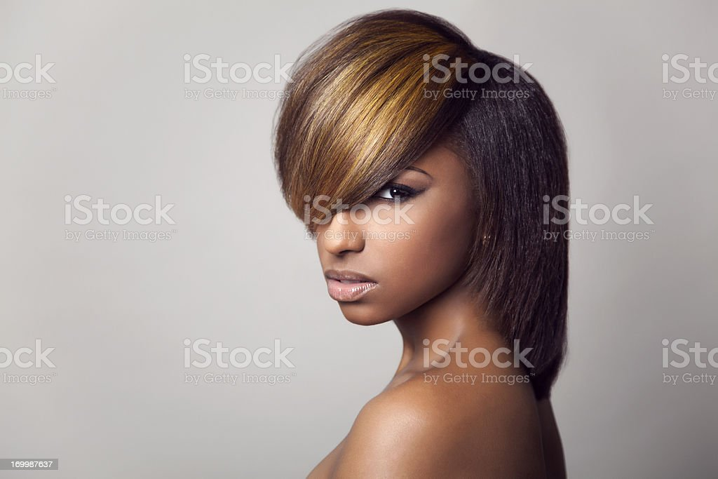 3/4 close-up of a model with highlight bang stock photo