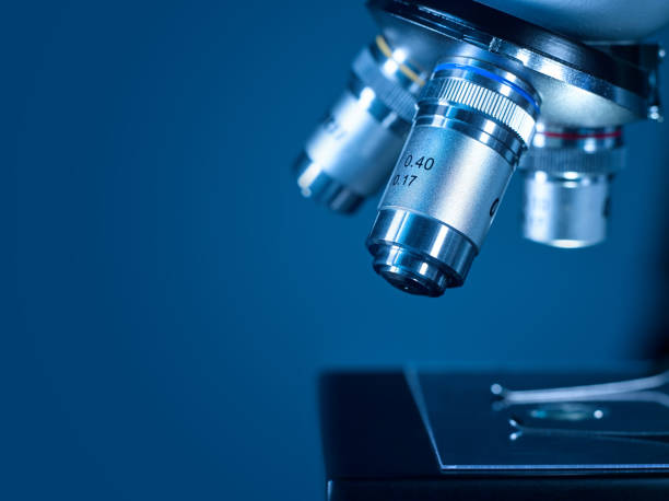 closeup of a modern microscope in a research laboratory - microscope stock photos and pictures