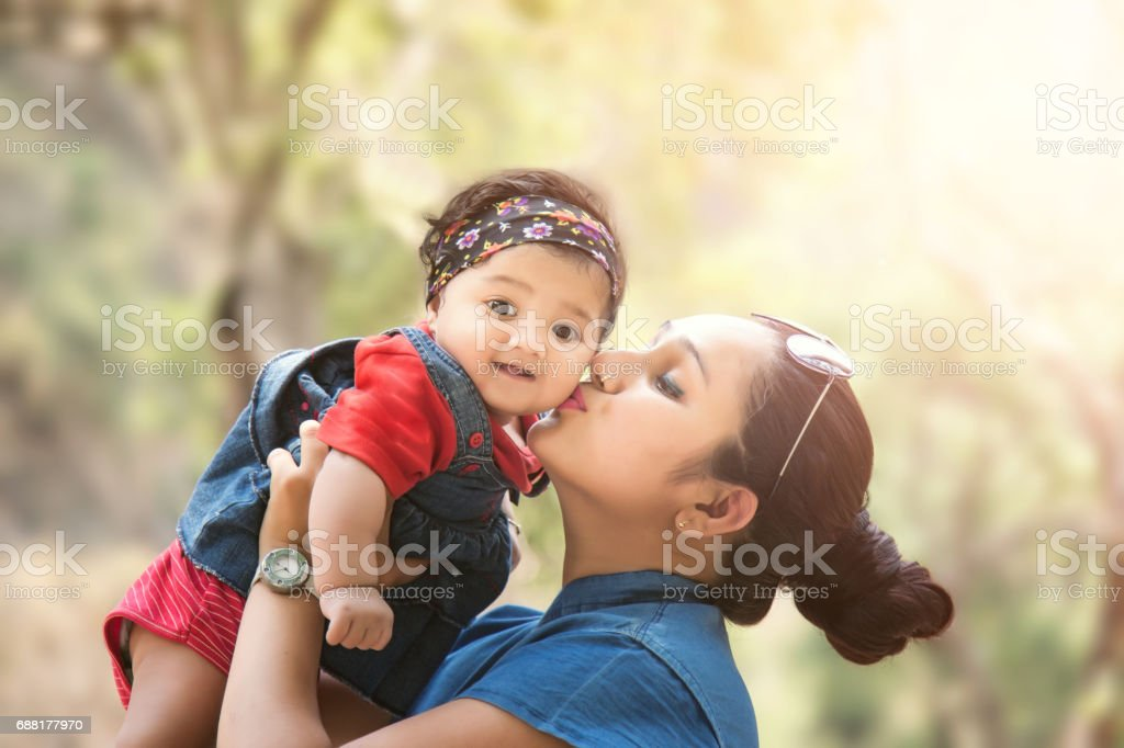 Close-up Of A Mother Loving Her Baby girl stock photo