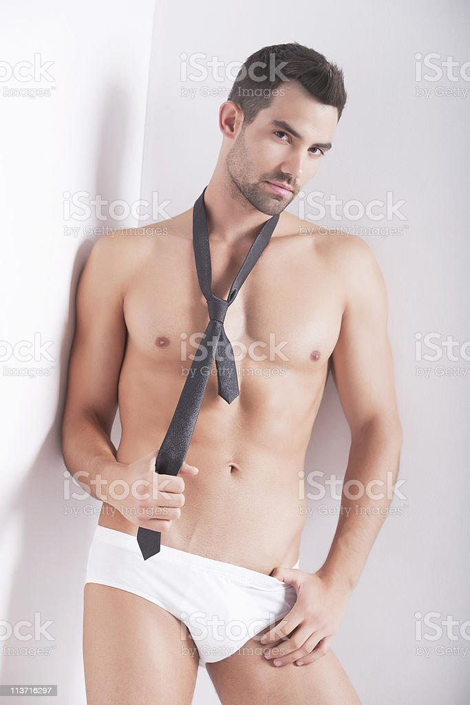 Closeup of a muscular handsome man in underwear royalty-free stock photo