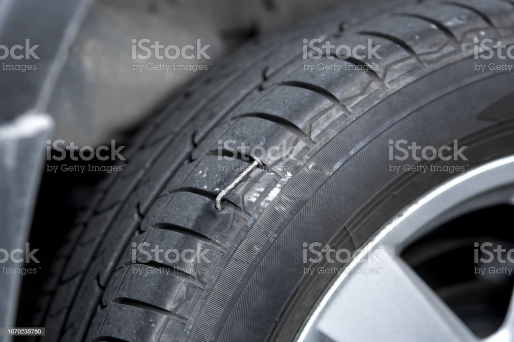 Close-up of a nail in a wheel. stock photo