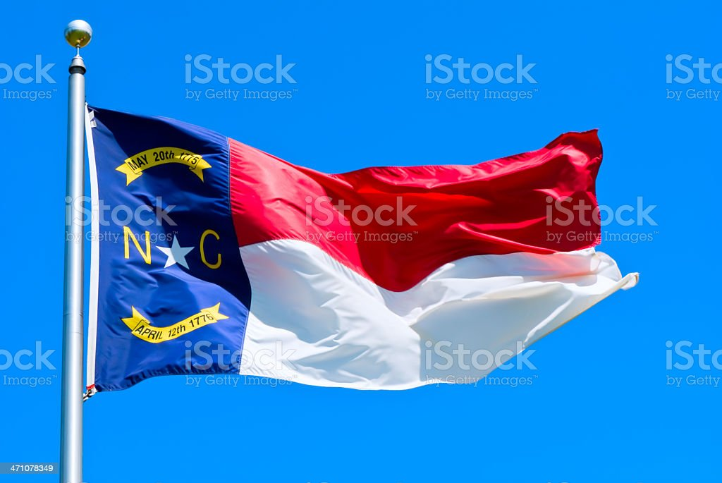 Close-up of a North Carolina flag that is flying in the air stock photo