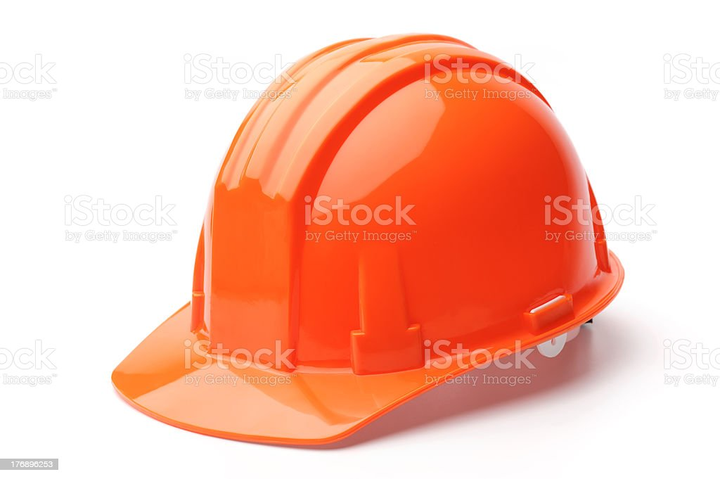 A close-up of a orange hard hat stock photo
