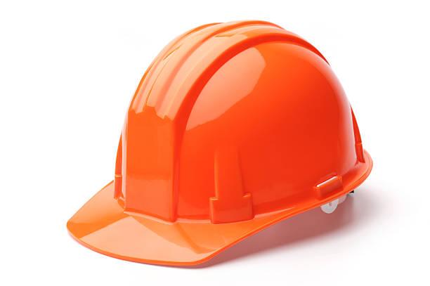 A close-up of a orange hard hat stock photo