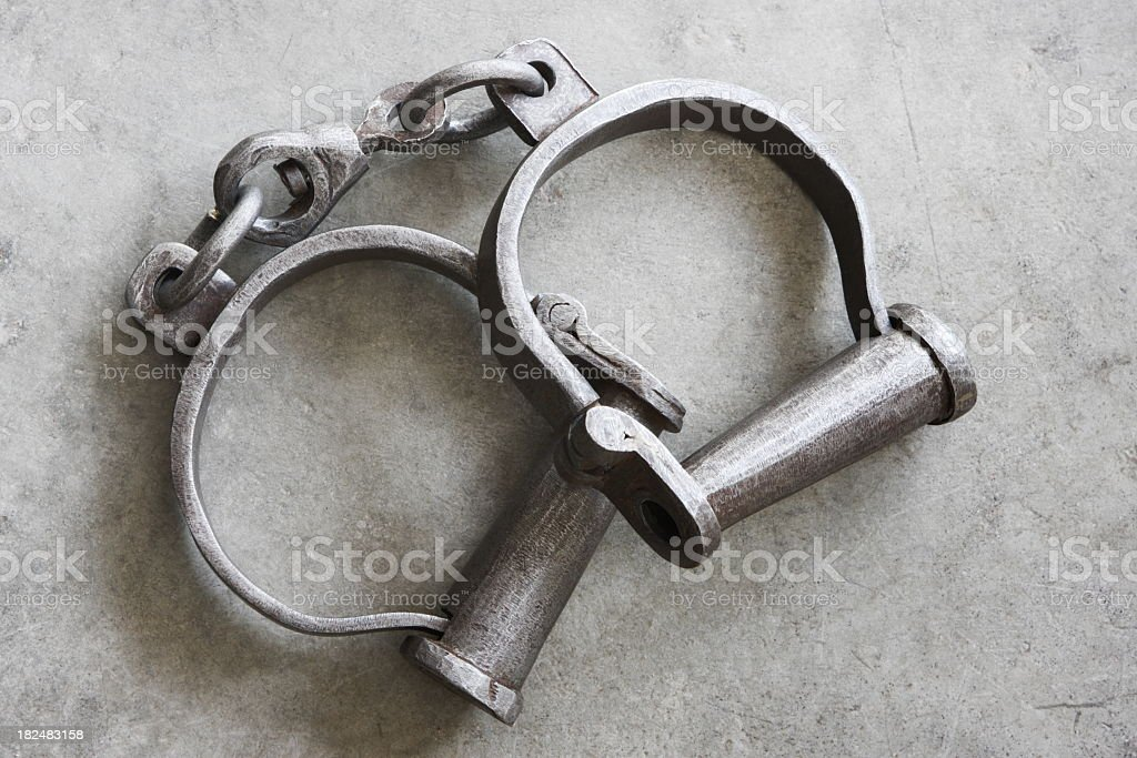 Close-up of a pair of antique metal slave shackles royalty-free stock photo