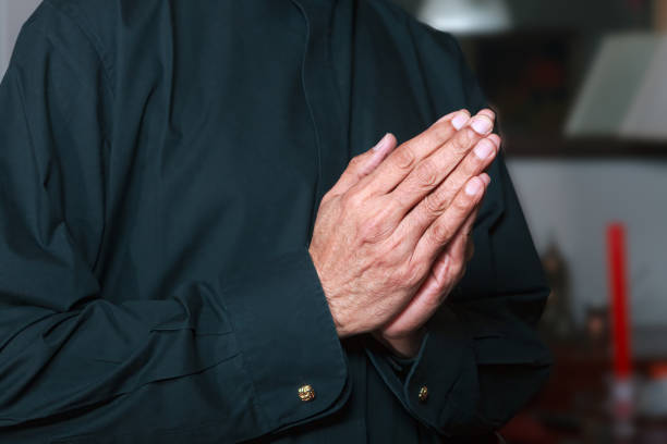 Close-up Of A Pair Of Brown Skinned Hands Of A 73 Year Old Asian Indian Male, Brought Together In Prayer stock photo