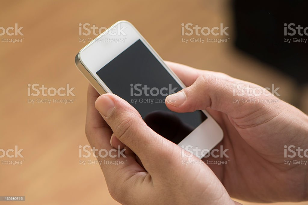 Close-up of a pair of hands holding a smartphone stock photo