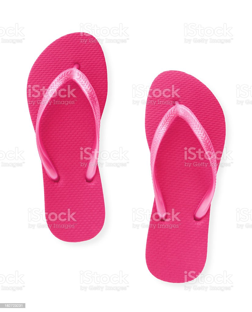 Close-up of a pair of pink flip flops isolated on white stock photo