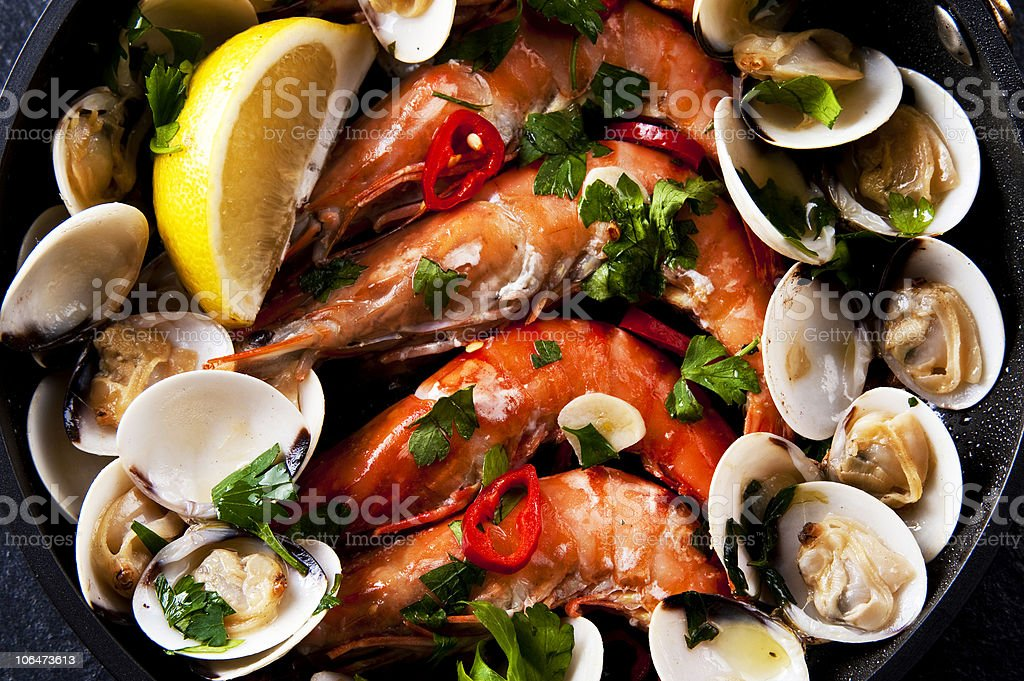 Close-up of a pan containing seafood tapas with prawns royalty-free stock photo