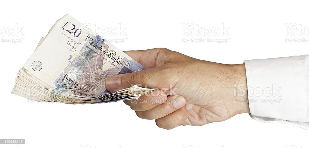 Close-up of a person holding cash in their hand stock photo