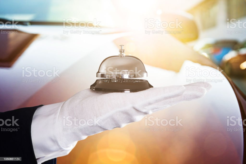 Close-up Of A Person Holding Service Bell stock photo