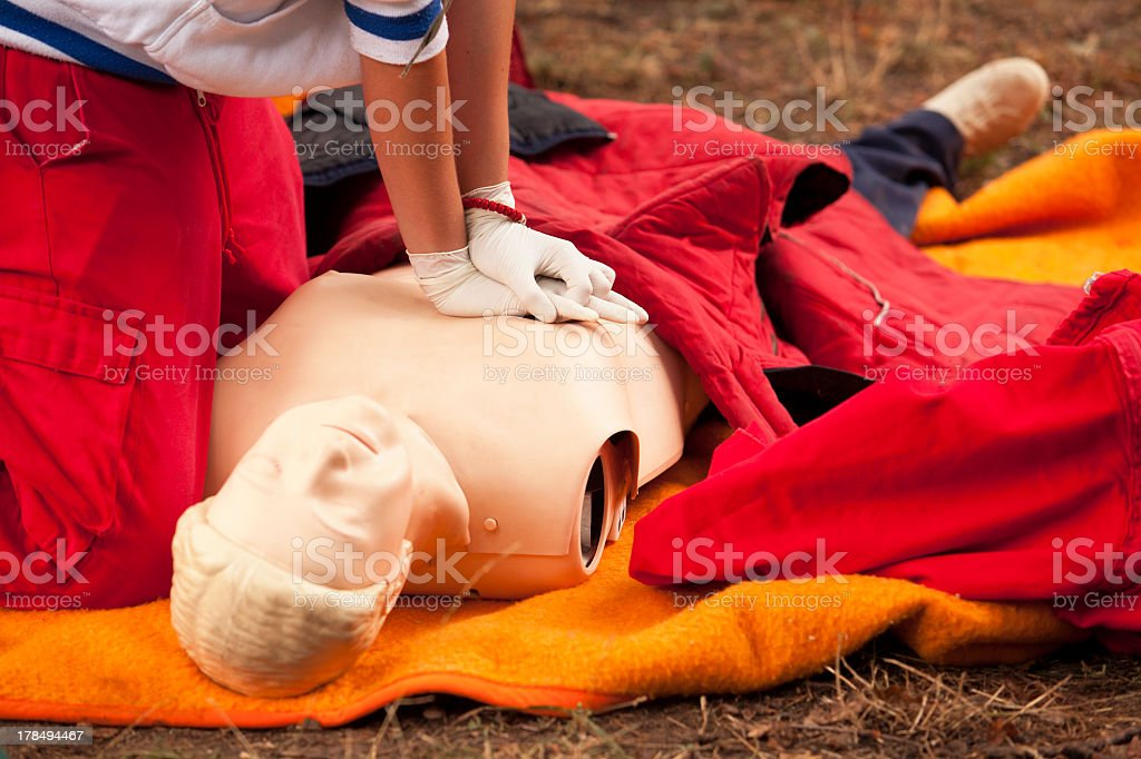 A close-up of a person in first aid training royalty-free stock photo