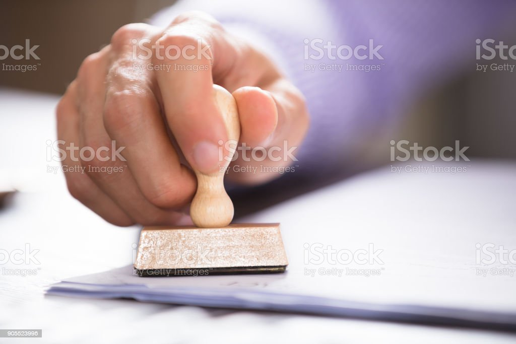 Close-up Of A Person Stamping On Document - foto stock