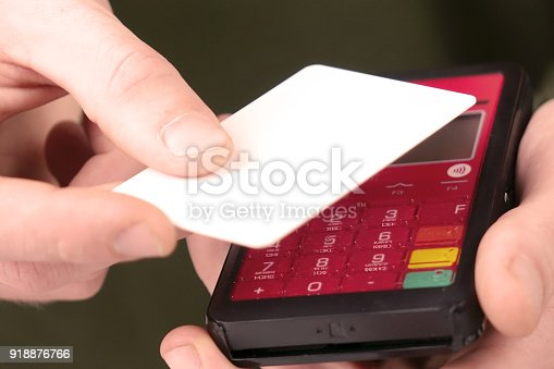 Close-up of a person using a credit card payment system