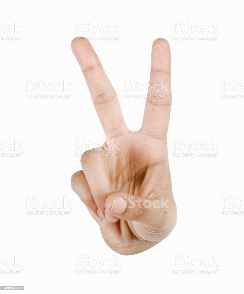 Close-up of a person's hand making a peace sign stock photo