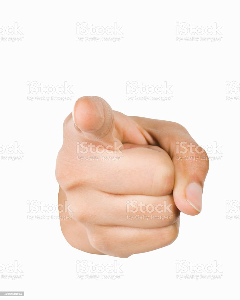 Close-up of a person's hand pointing forward stock photo