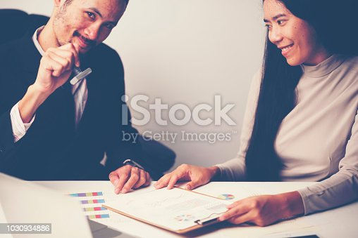 1007078074 istock photo Close-up Of A Person's Hand Stamping With Approved Stamp On Document At Desk 1030934886