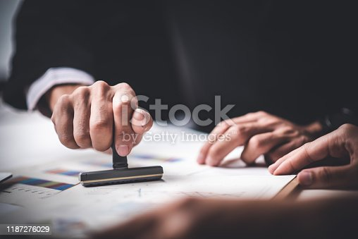 944422446istockphoto Close-up Of A Person's Hand Stamping With Approved Stamp On Text Approved Document At Desk,  Contract Form Paper 1187276029