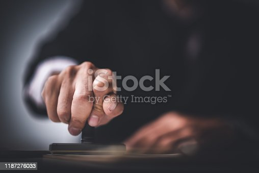 944422446istockphoto Close-up Of A Person's Hand Stamping With Approved Stamp On Text Approved Document At Desk,  Contract Form Paper 1187276033