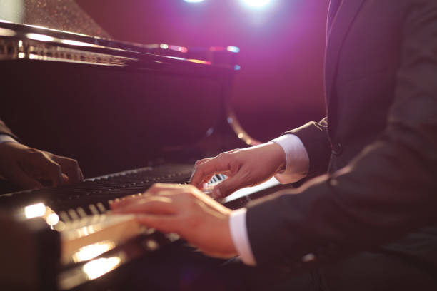 Close-up of a piano player Close-up of a piano player performing pianist stock pictures, royalty-free photos & images