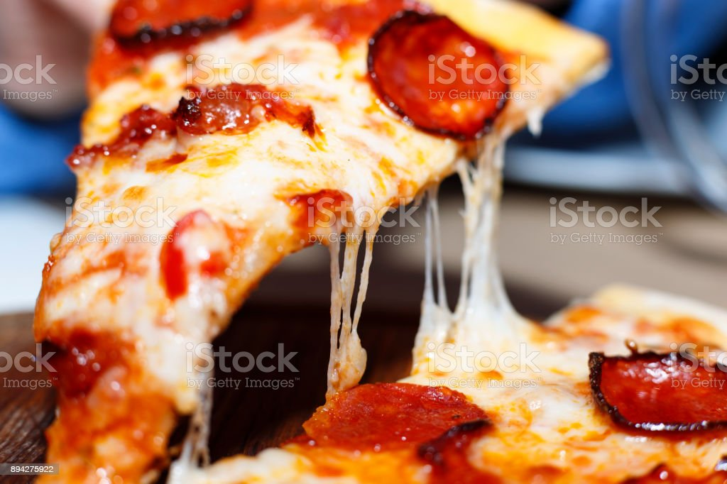 Closeup of a piece of pepperoni pizza. Italian pizza. stock photo
