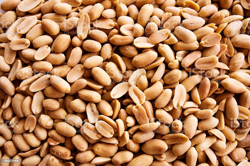 Close-up of a pile full of peanuts stock photo