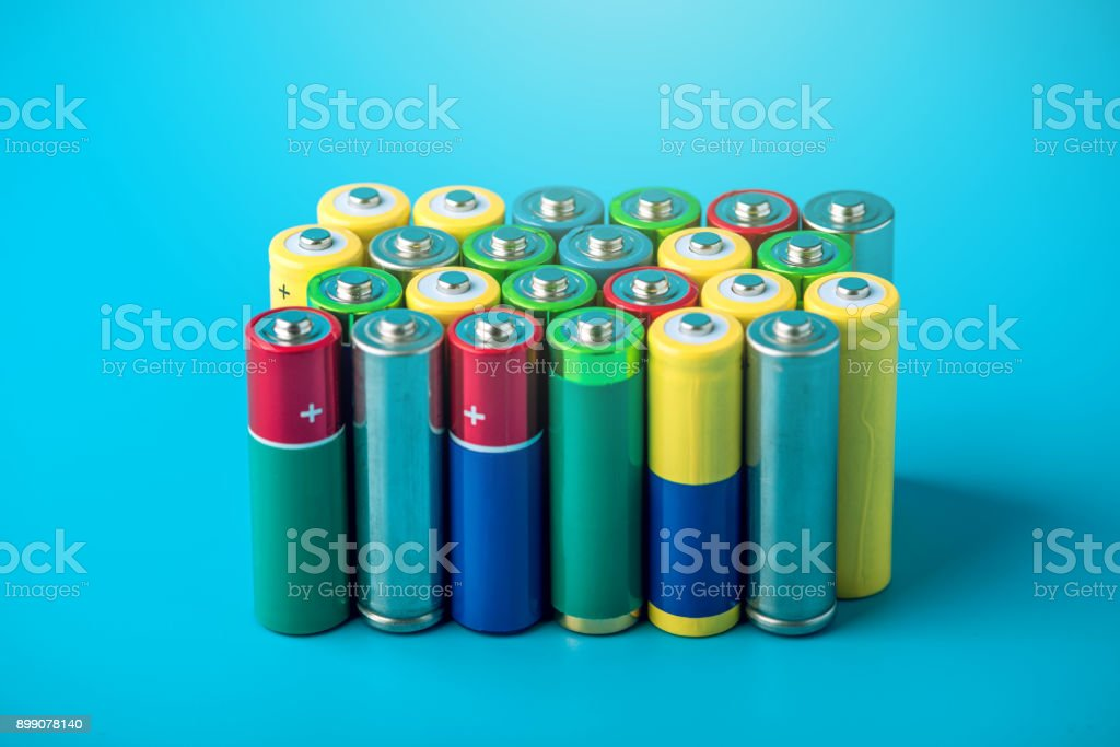 Closeup of a pile of color used alkaline AA batteries. Concept recycling of harmful substances for ecology stock photo