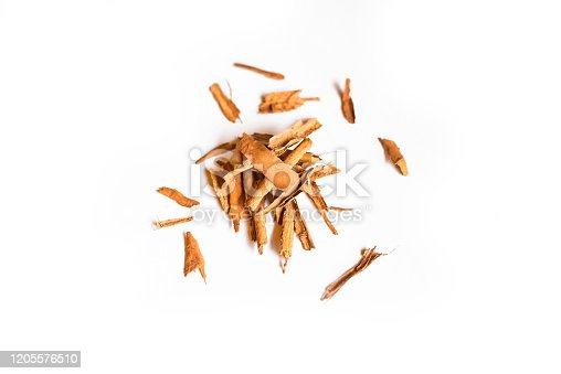 Closeup of a pile of organic cinnamon sticks isolated on a white background