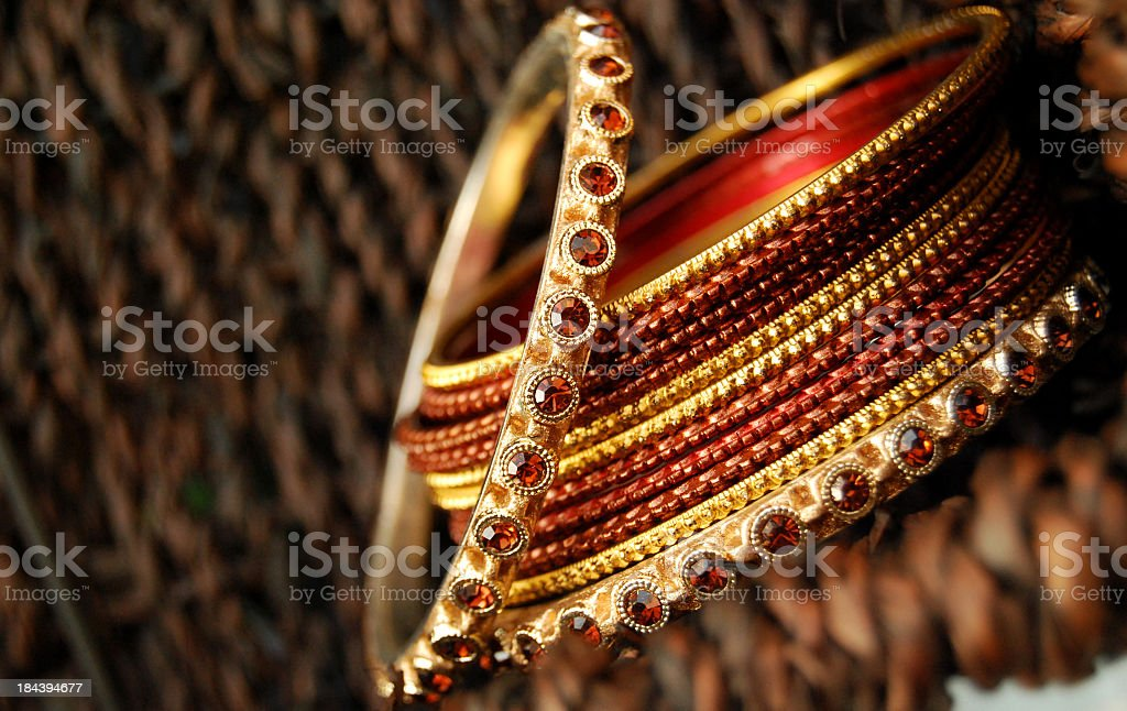 Close-up of a pile of red and gold bangles stock photo