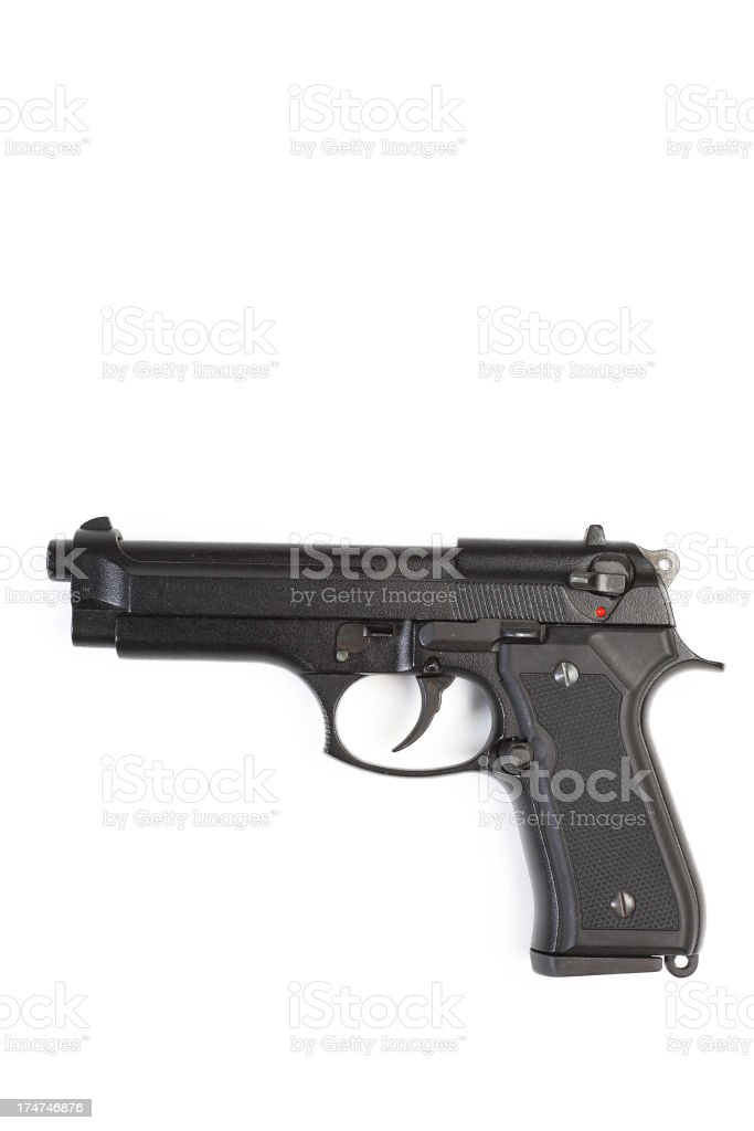 Closeup of a pistol isolated on white background royalty-free stock photo
