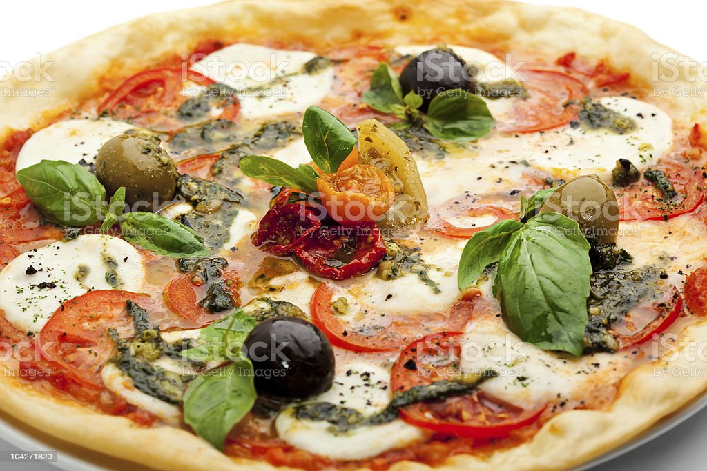 Close-up of a pizza topped with fresh ingredients royalty-free stock photo