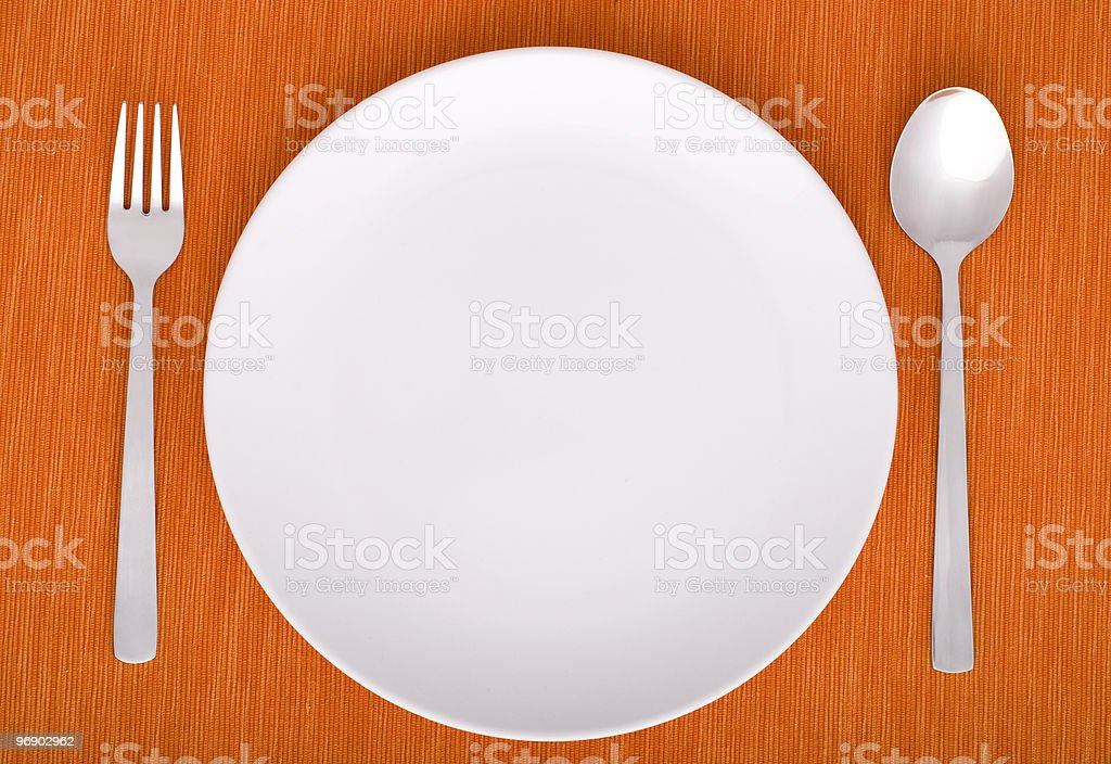 closeup of a place setting with dinner-plate royalty-free stock photo