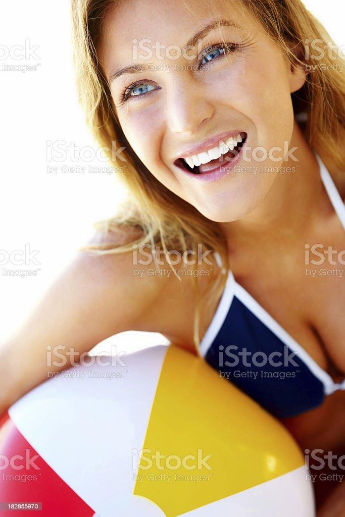 Close-up of a playful bikini woman holding beach ball royalty-free stock photo